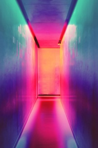 A corridor lit by different color light sources, creating a surreal sense.