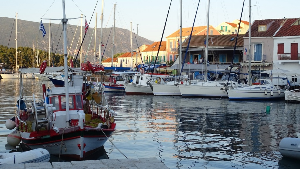 Partial vies of the seaside village of Fiscardo in Kefalonia with many sailing boats docked in the marina.