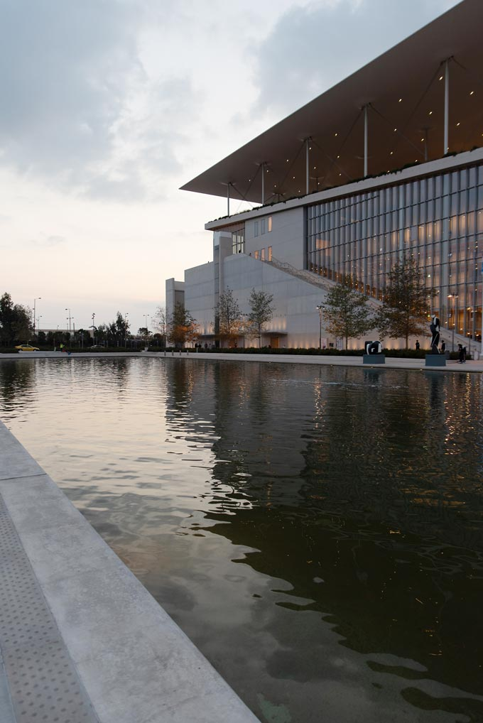 View of the canal and the Stavros Niarchos Foundation Culture Center after sunset.