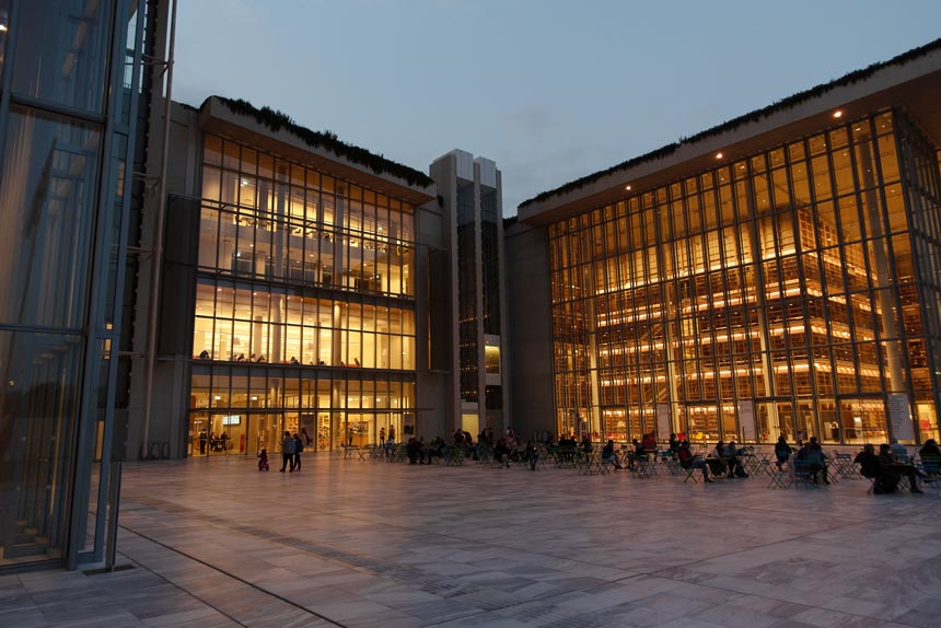The Agora at the Stavros Niarchos Foundation Culture Center after sunset.