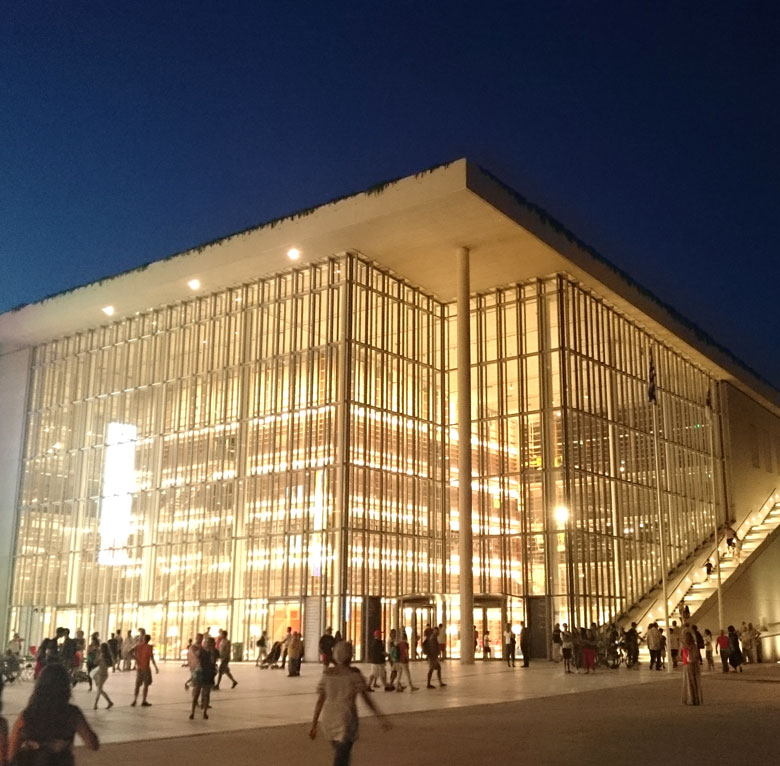 Partial view of the library from the Stavros Niarchos Cultural Center, lit after sunset hours. Image by Velvet.