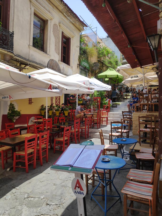 One of the alleys of Plaka with lots of tavernas and restaurants and outdoor seating.