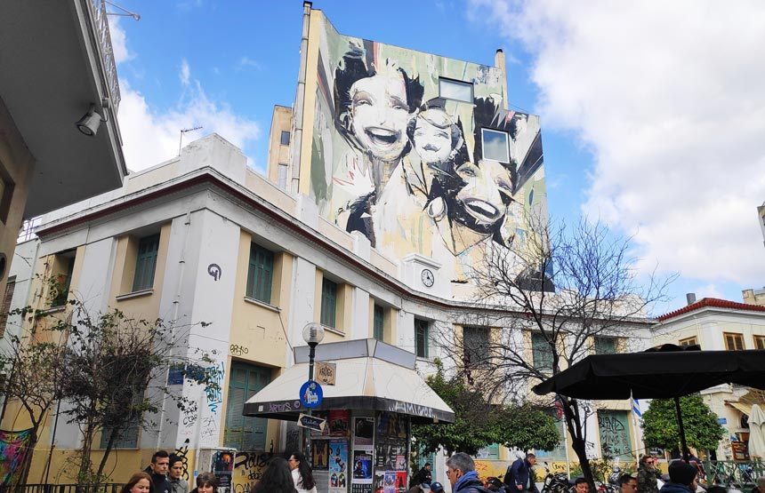 A large wall mural from street art in the square of Psiri downtown Athens.