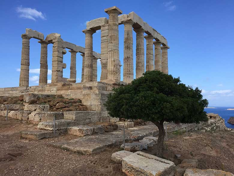 View of the Temple of Poseidon in Sounion (Attica) standing on a cliff by the seaside
