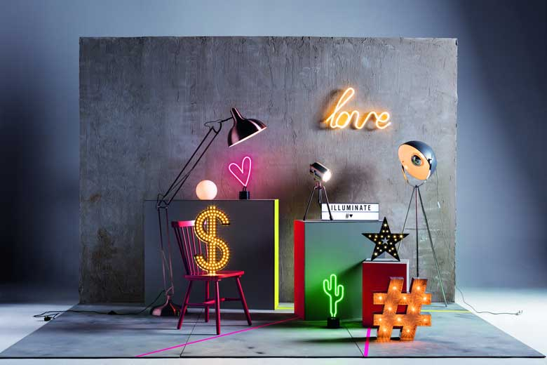 The coolest collection of lighting fixtures - neon sign, floor lamp, table lamp and more. Image by Debenhams.