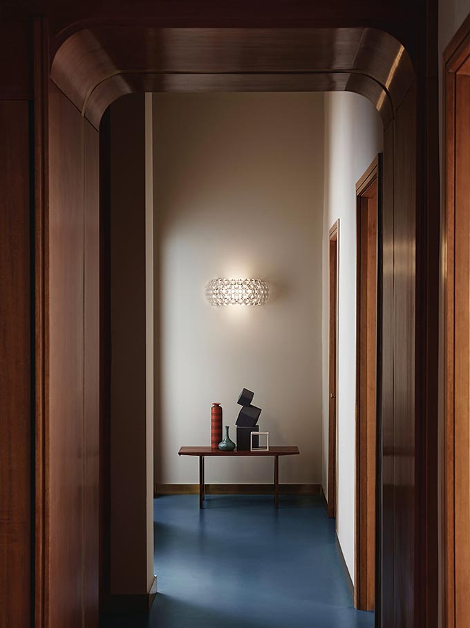 A wall sconce featured at the end of a corridor. Image via Nest.co.uk.