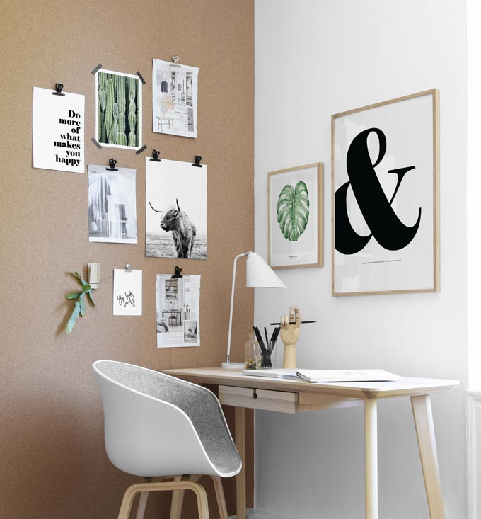 A home office with a gallery wall that includes some typography prints for impact. Image by Desenio.