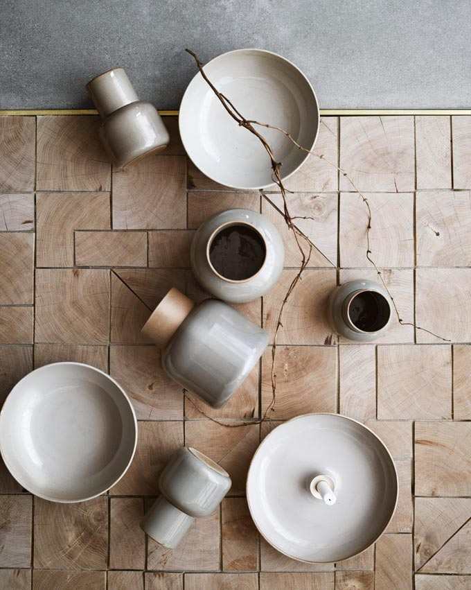 Ceramic ware on a flatlay designed by Cecilie Manz: the Fritz Hansen Earthenware Jar Vase. Image via Nest.co.uk.