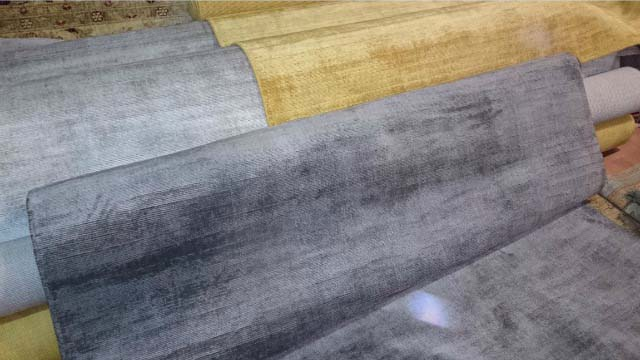Bamboo silk rugs in different shades of grey and a golden one