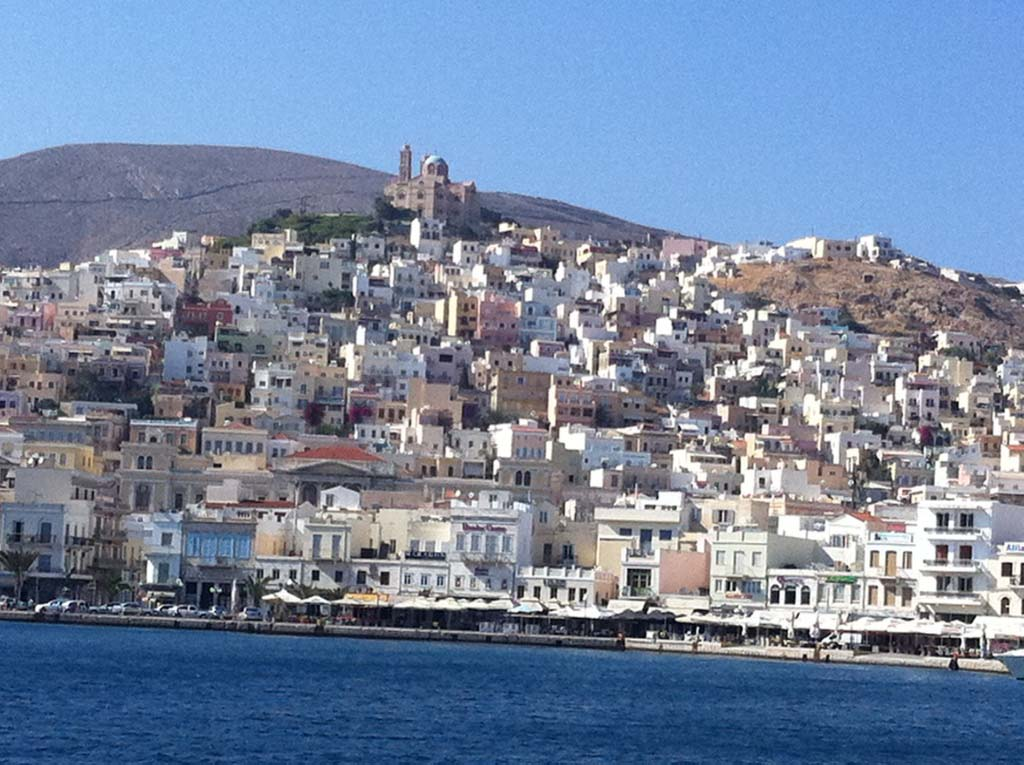 Partial view of the main town of Syros island from taken from the one end of the port