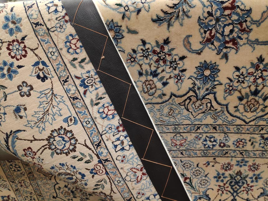 A fine quality Persian rug detail (front and backend)