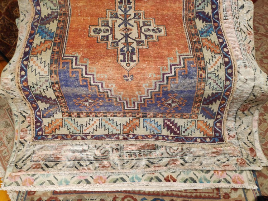 A Persian vintage rug with geometric patterns
