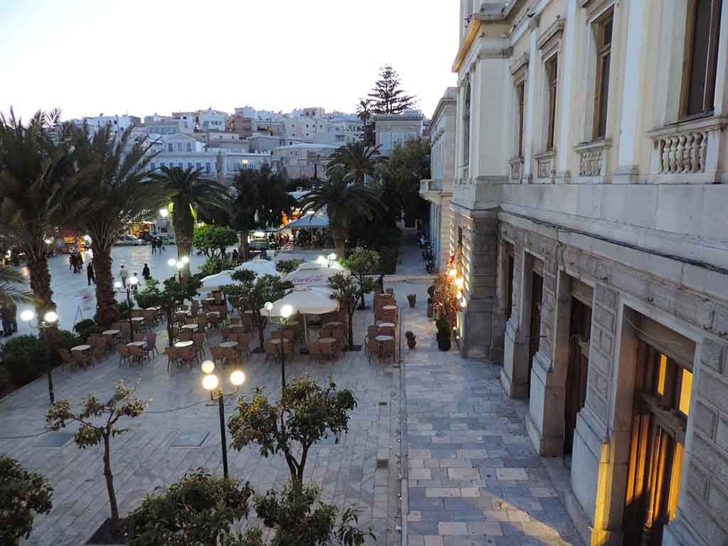 Partial view of the Miaouli Square from the Town Hall after sunset