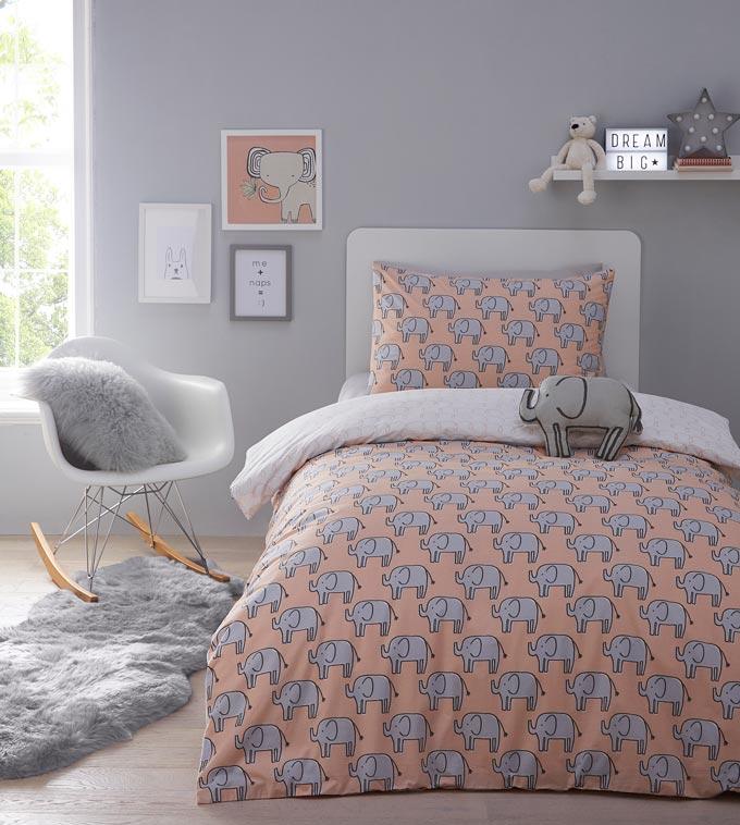 A stylish minimal kids bedroom with a playful print pattern bedding. Image by Debenhams.