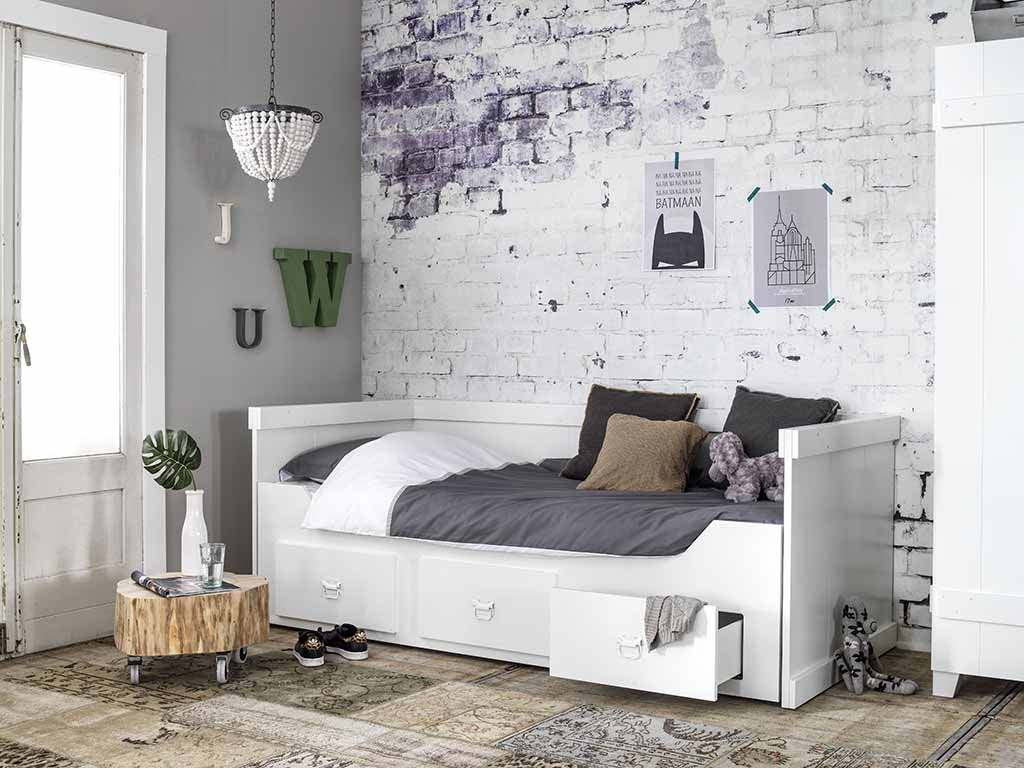 A beautiful bedroom with a white bed against a white brick accent wall. Image by Cuckooland.