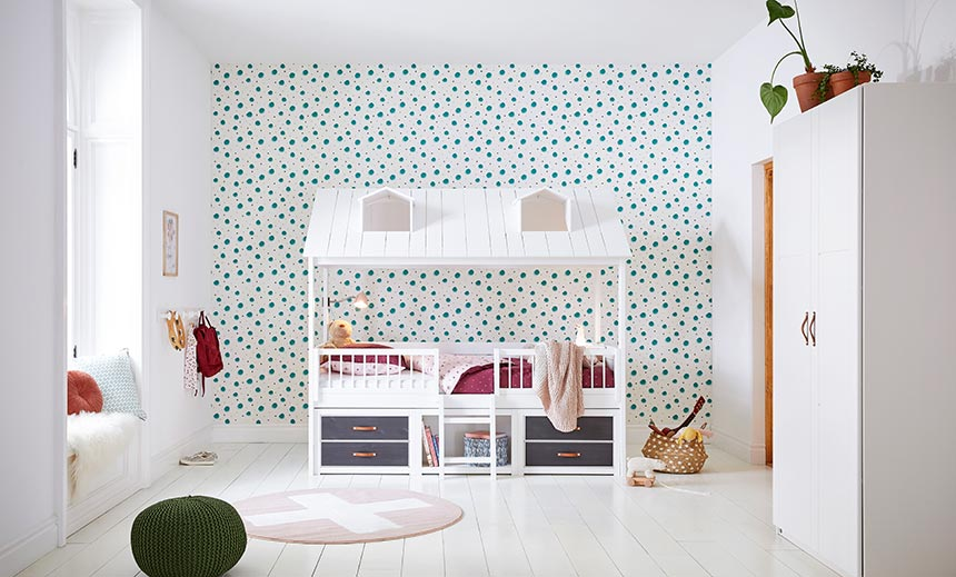 A beautiful kid's room with a theme bed in front of accent wall. Image by Cuckooland.