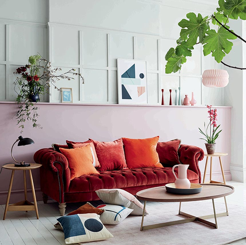 I love this deep rusty red velvet sofa that feels like a more modern take on a very classic sofa type. Image by DFS Furniture.