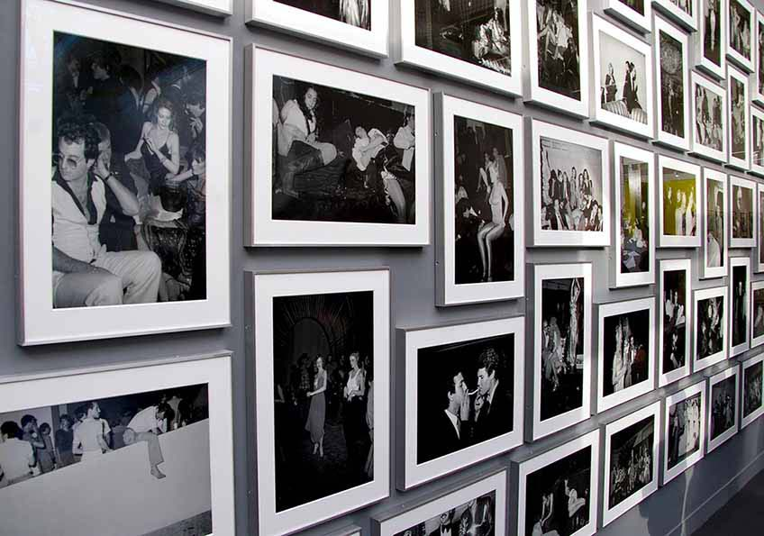 A black and white photography art gallery wall taken from an angle