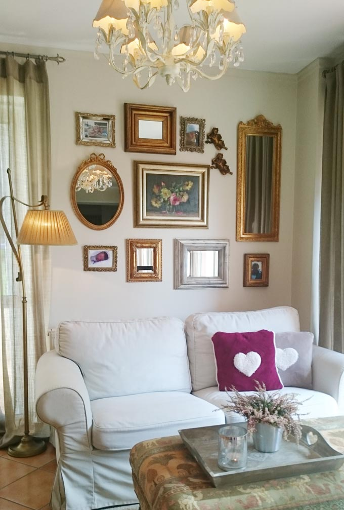 Elisabeth's vignette featuring a white sofa with a floor lamp next to it and an accent gallery wall.