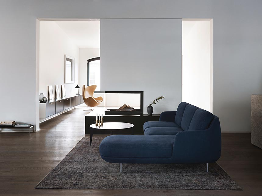 I love this Fritz Hansen Lune three seater sofa with a chaise longue that sits on top of the perfect sized contemporary area rug in this contemporary minimal space. Image by Nest.co.uk.