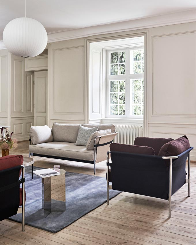 A stylish contemporary living room with two armchairs and an off white sofa. Image via Nest.co.uk.