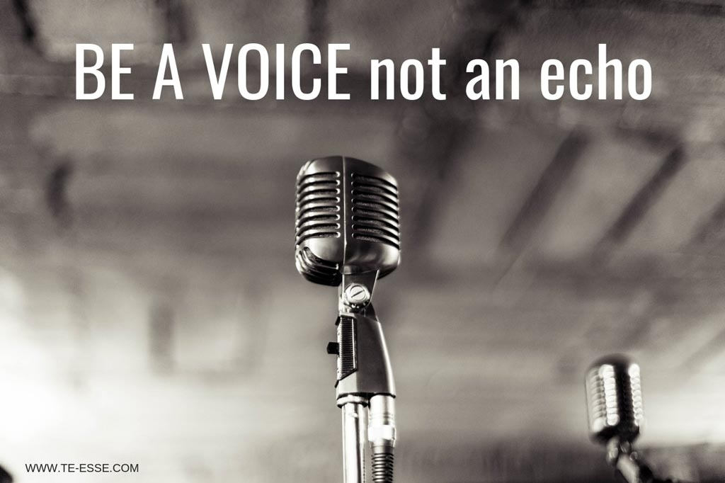 A black and white image of an old microphone. Be a voice not an echo reads the writing over it.