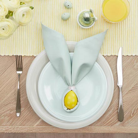 A yellow runner and a yellow egg wrapped in a towel like a bunny face, surely makes a great Easter decorating idea. Image via John Lewis.