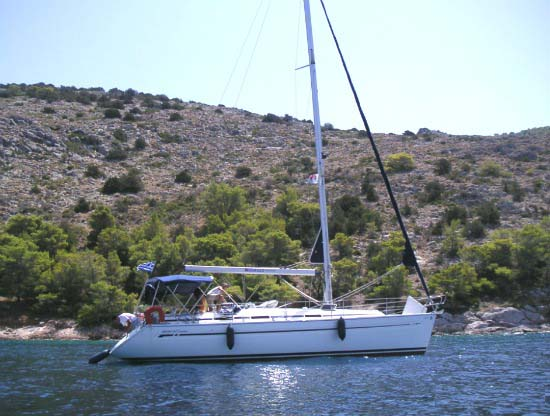 image of our rented sailboat near Hydra's coast