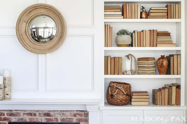 A built-in bookcase with books placed in ways where the spine is hidden for a uniform look; styled by Rachel Paxton
