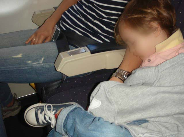 Son napping on my arm during the flight