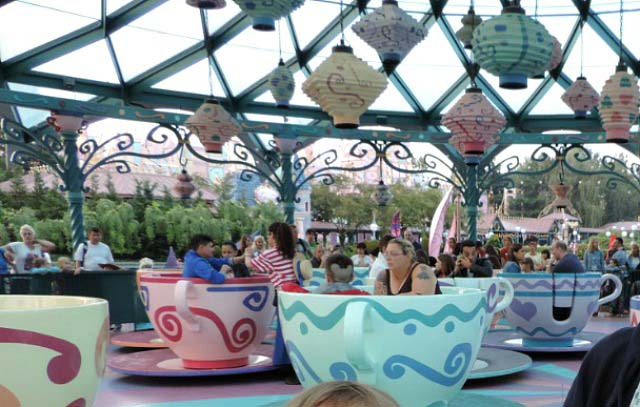 The dancing cups in Disneyland Paris keep going round and round while you're sitted.