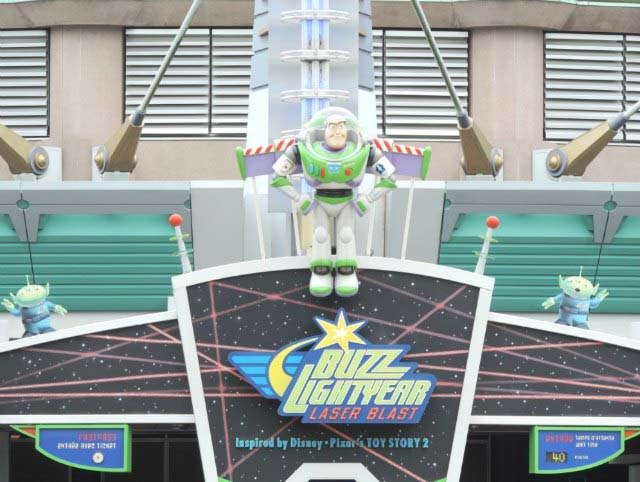 Buzz Lightyear fixed on the canopy roof over the entrance to one more ride in Spaceland Disneyland Paris.
