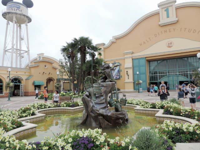 Standing in front of the Walt Disney's Studio theme park