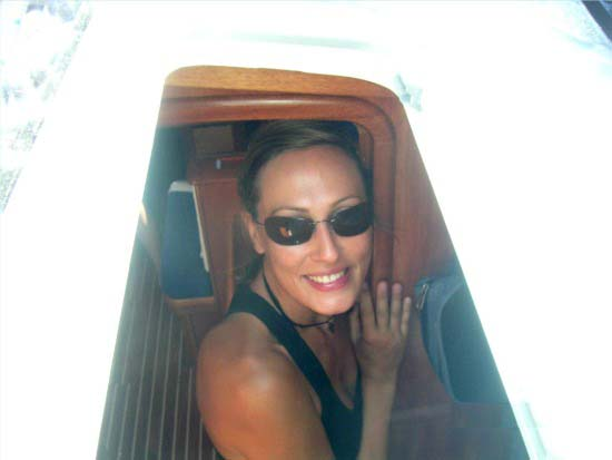 Velvet going down into the sailing boat