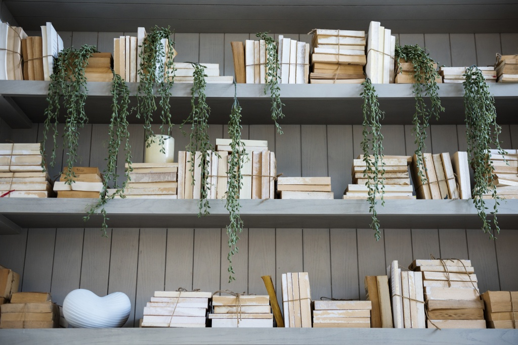A close up of a bookcase styled with a neutral palette in mind.