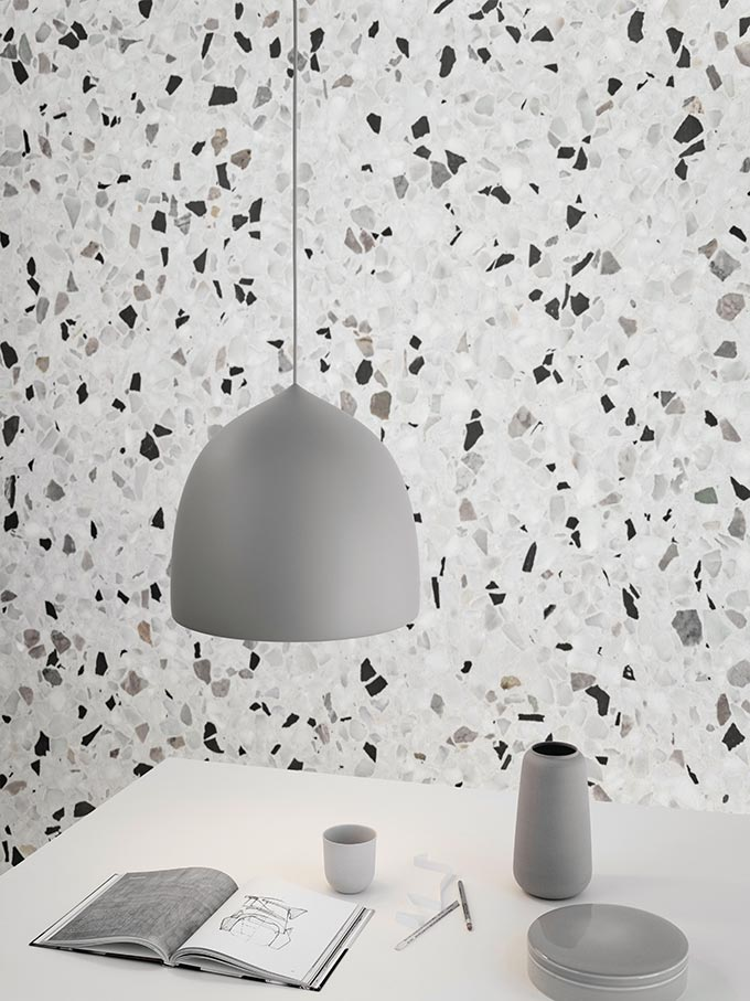 The Lightyears Suspence Pendant Light Designed by GamFratesi, stands out in front of a terrazzo wallpaper treatment. Image by Nest.