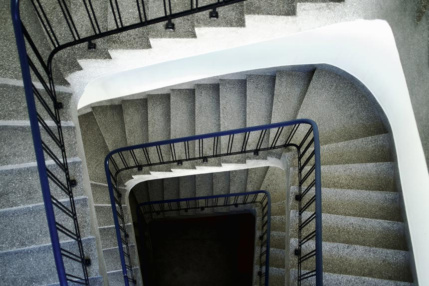 A stairwell seen from above with terrazzo lined steps.