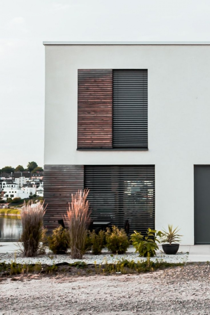The external facade of a contemporary minimal styled building with Venetian blinds.