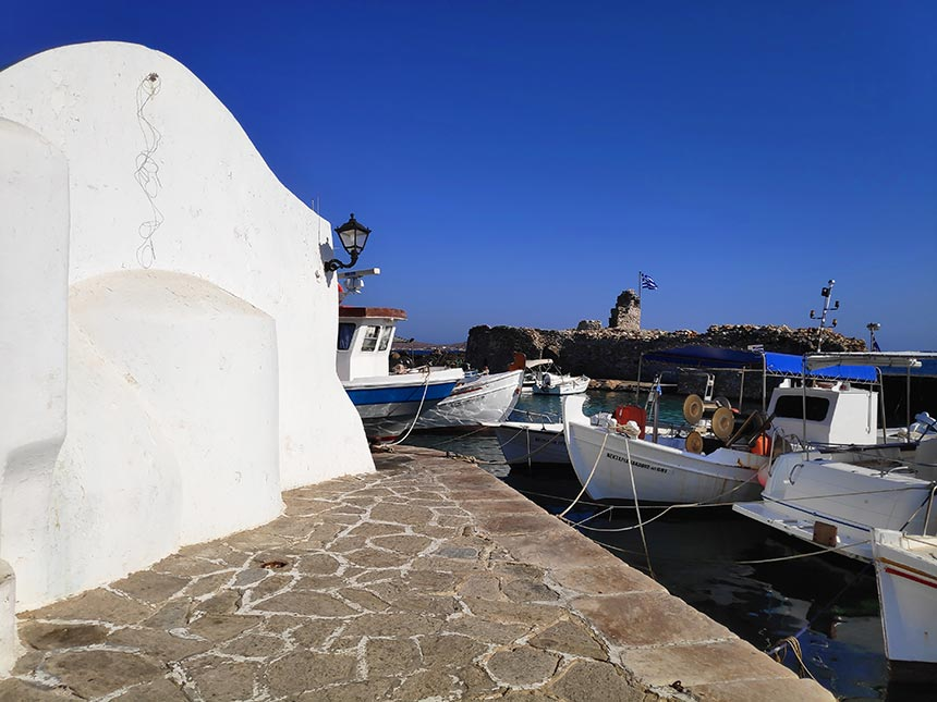 Partial view of the port of Naoussa in Paros with the white chapel on the left. Image by Velvet.