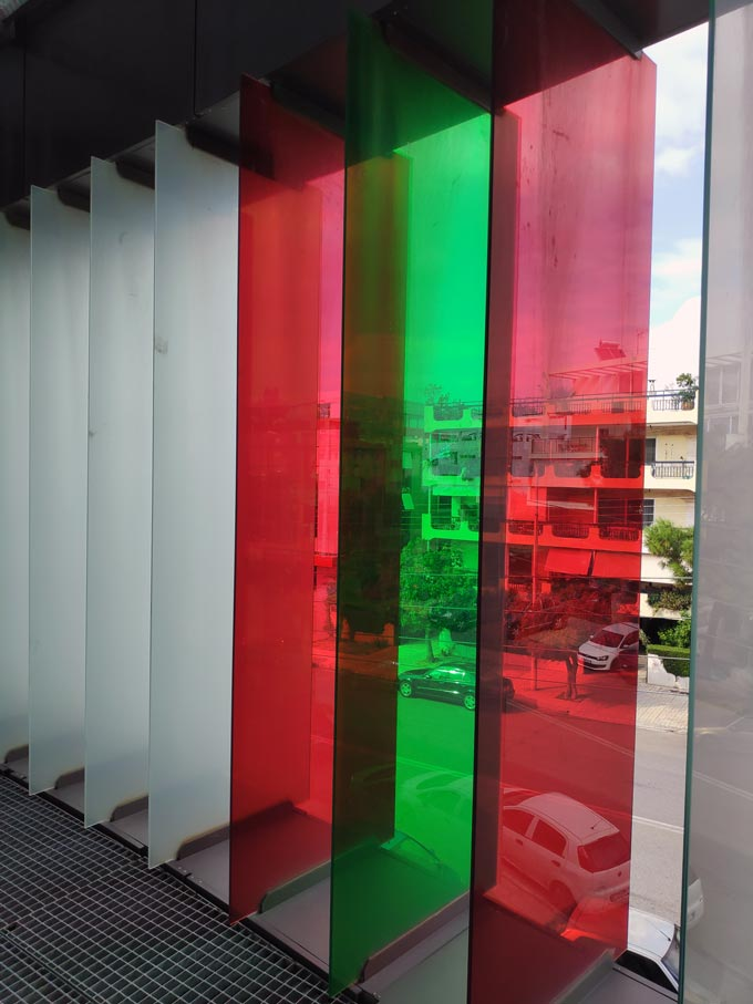 Colored glass panels used on the facade of a building. Image by Velvet.