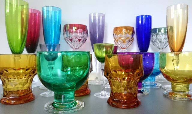 Champagne, wine, liqueur, and soda glasses and ice cream bowls all made of colored glasses belonging to my collection