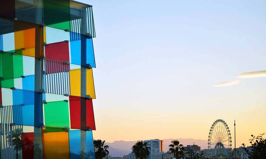 Partial view of a high rise building's facade made with various colored glass panels