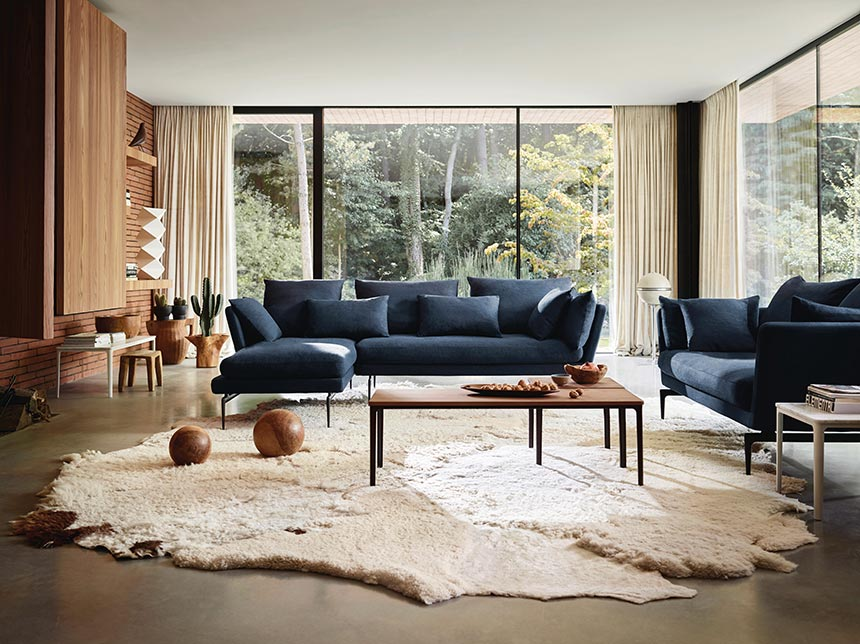 A minimal but warm and cozy living room with the Vitra Suite blue sofas creating a focal point. Image by Nest.