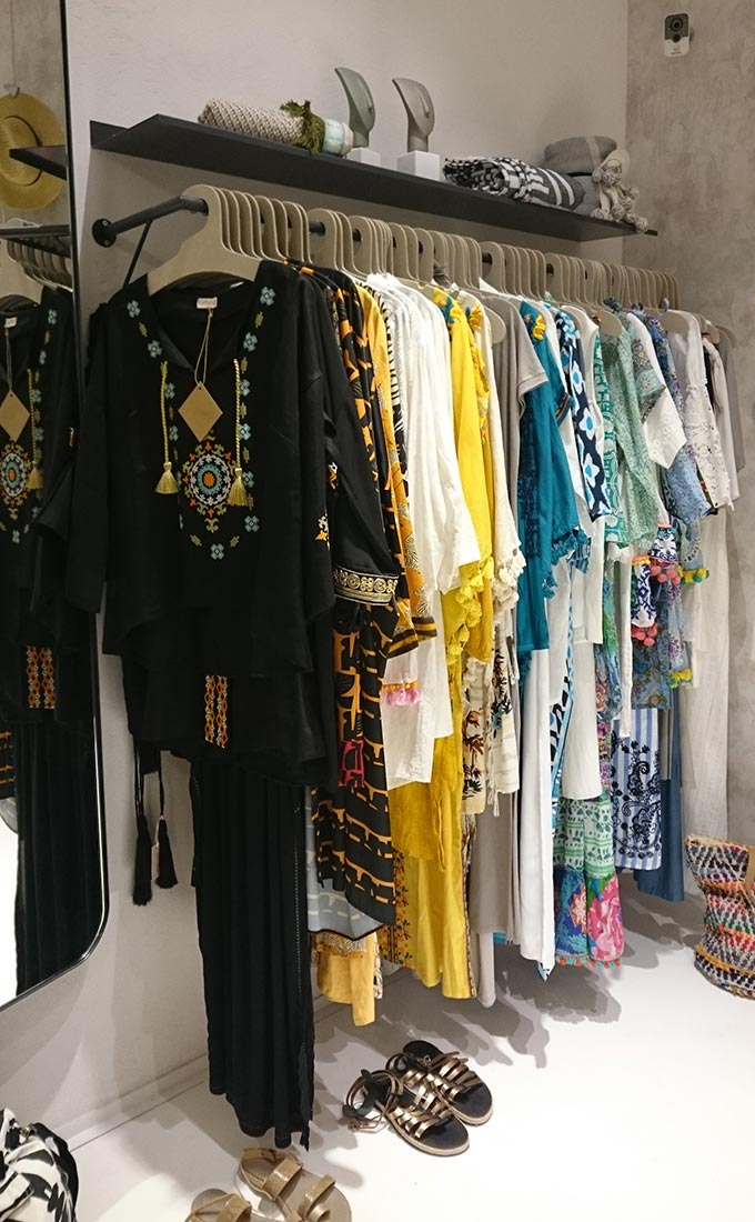 Boho inspired outfits hanging at a Greek island retail store. Image by Velvet.