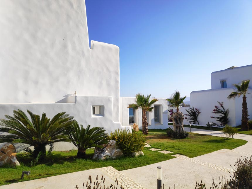 A housing complex of low rise white washed buildings in a typical Cycladic architecture in Paros.