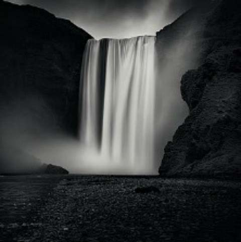 A black and white photo of a stunning waterfall in Iceland by Emmanuel Coupe owned by House of Photography.