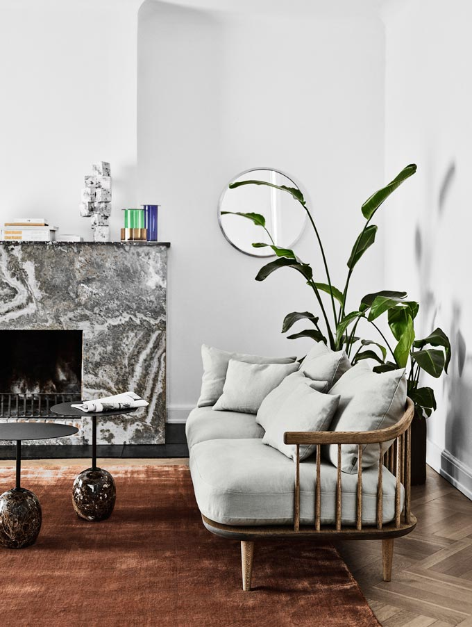 A sofa with the Lato side tables that are crafted from marble and steel, inspired by a lollipop and a veined marble fireplace make up this contemporary setting. Image by Nest.