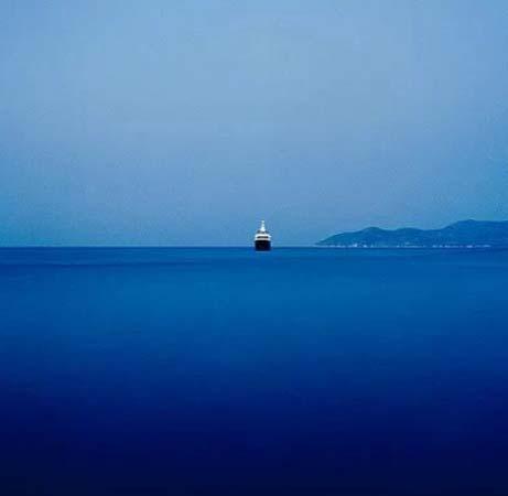 A ship sailing in a deep blue sea. Image by Stratos Kalafatis