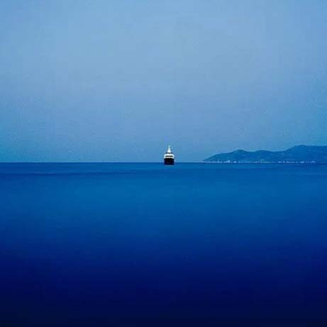 A ship sailing in a deep blue sea. Image by Stratos Kalafatis