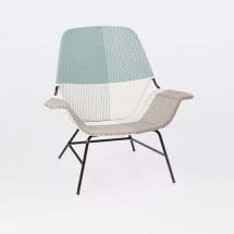 A colorblocked woven lounge chair.